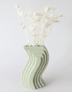"""Another funky pick with mid-century modern flair, this mint green vessel will stand out whether it's stuffed with a fresh bouquet, a single stem, or nothing at all. $28, Afloral. <a href=""""https://www.afloral.com/products/mint-modern-porcelain-nordic-geometric-vase"""" rel=""""nofollow noopener"""" target=""""_blank"""" data-ylk=""""slk:Get it now!"""" class=""""link rapid-noclick-resp"""">Get it now!</a>"""