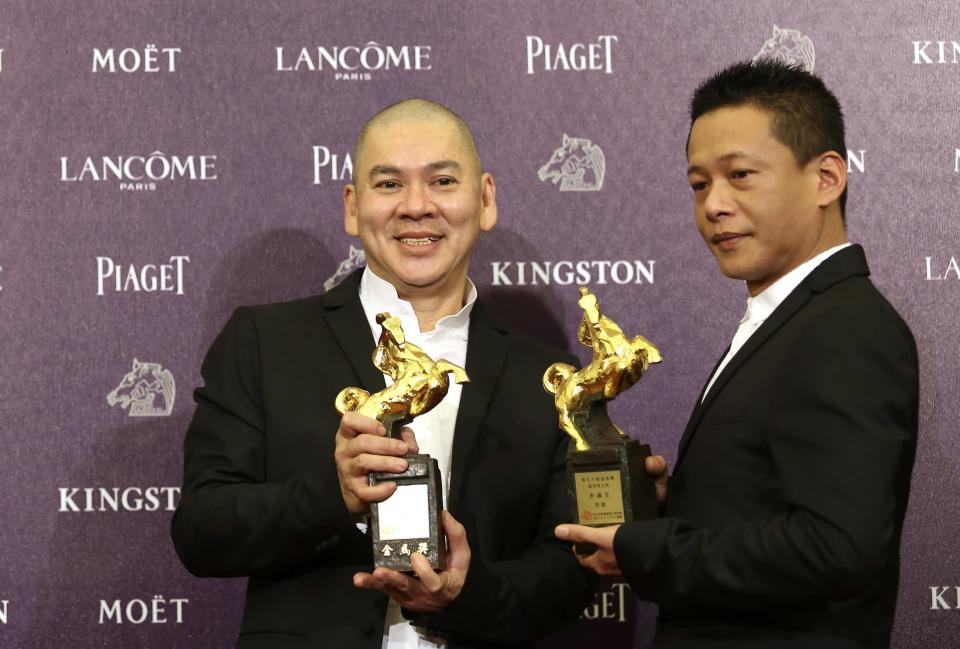 """Taiwanese director Tsai Ming-liang (L) and Taiwanese actor Lee Kang-sheng celebrate winning Best Director and Best Leading Actor for """"Stray Dogs"""" at the 50th Golden Horse Film Awards in Taipei November 23, 2013. REUTERS/Patrick Lin (TAIWAN - Tags: ENTERTAINMENT)"""
