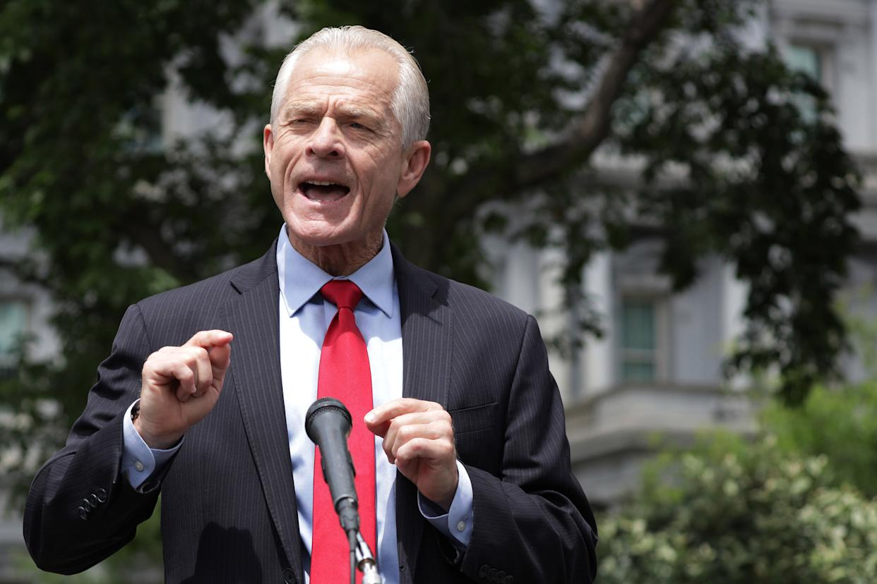 Image: Director of Trade and Manufacturing Policy Peter Navarro speaks to members of the press outside the West Wing of the White House (Alex Wong / Getty Images)