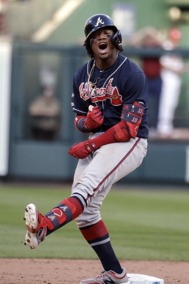 Atlanta Braves' Ronald Acuna Jr. reacts after hitting a double during the ninth inning in Game 4 of a baseball National League Division Series against the St. Louis Cardinals, Monday, Oct. 7, 2019, in St. Louis. (AP Photo/Charlie Riedel)