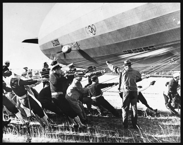 <p>Navy men and others moor the Hindenburg at the Lakehurst Naval Station. (Hulton-Deutsch Collection/Corbis via Getty Images) </p>
