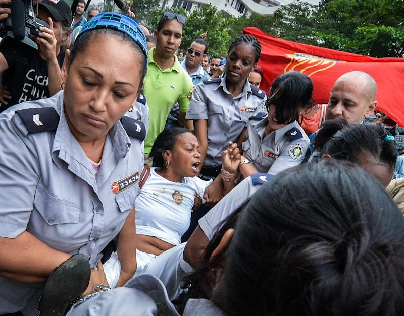 A member of the Ladies in White Human Rights organization is arrested by Cuban police on December 10, 2015 in Havana
