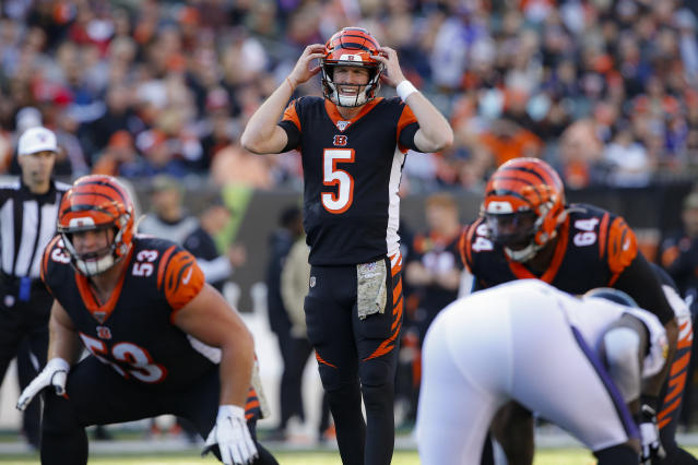 Cincinnati Bengals quarterback Ryan Finley (5) calls a play during the first half of NFL football game against the Baltimore Ravens, Sunday, Nov. 10, 2019, in Cincinnati. (AP Photo/Gary Landers)
