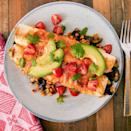 """<p>These enchiladas are stuffed with a hearty combination of corn, beans, and courgette and topped with two types of cheese. Garnished with avocado, tomato, and coriander, it's the definition of a healthy and hearty meal.</p><p>Get the <a href=""""https://www.delish.com/uk/cooking/recipes/a30620767/vegetarian-enchiladas-recipe/"""" rel=""""nofollow noopener"""" target=""""_blank"""" data-ylk=""""slk:Vegetarian Enchiladas"""" class=""""link rapid-noclick-resp"""">Vegetarian Enchiladas</a> recipe.</p>"""