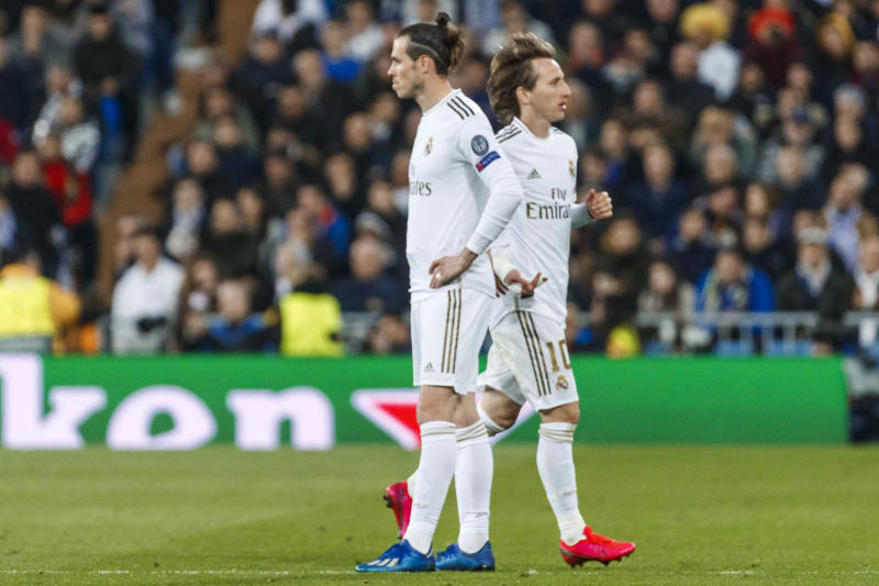 MADRID, SPAIN - FEBRUARY 26: (BILD ZEITUNG OUT) Gareth Bale of Real Madrid and Luka Modric of Real Madrid look on during the UEFA Champions League round of 16 first leg match between Real Madrid and Manchester City at Bernabeu on February 26, 2020 in Madrid, Spain. (Photo by DeFodi Images via Getty Images)