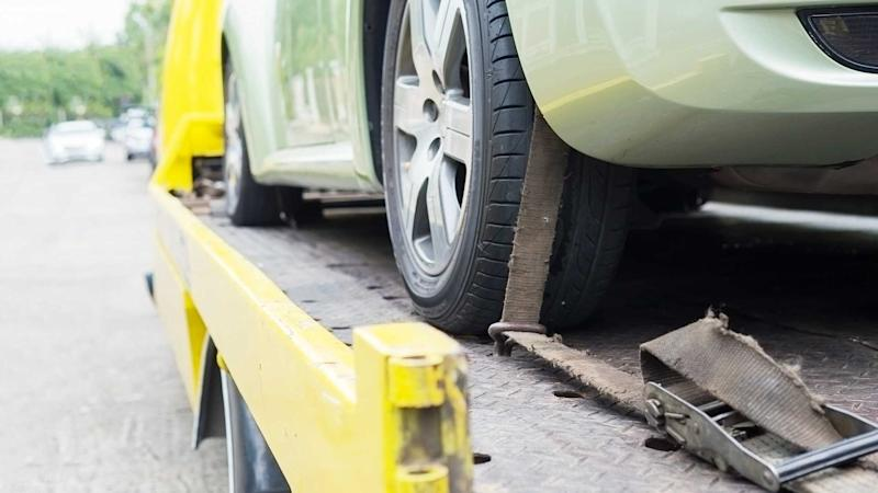 Breakdown lorry carrying disabled car
