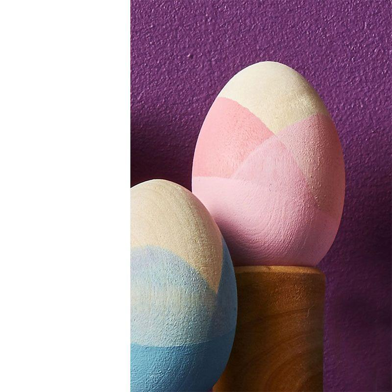 "<p>These unique eggs up the ante when it comes to decorating. The triple-dipped look makes these eggs come out super elegant.</p><p><em>Get the tutorial at <a href=""https://www.goodhousekeeping.com/holidays/easter-ideas/g419/easter-egg-decorating-ideas/?slide=18"" rel=""nofollow noopener"" target=""_blank"" data-ylk=""slk:Good Housekeeping."" class=""link rapid-noclick-resp"">Good Housekeeping.</a></em></p>"