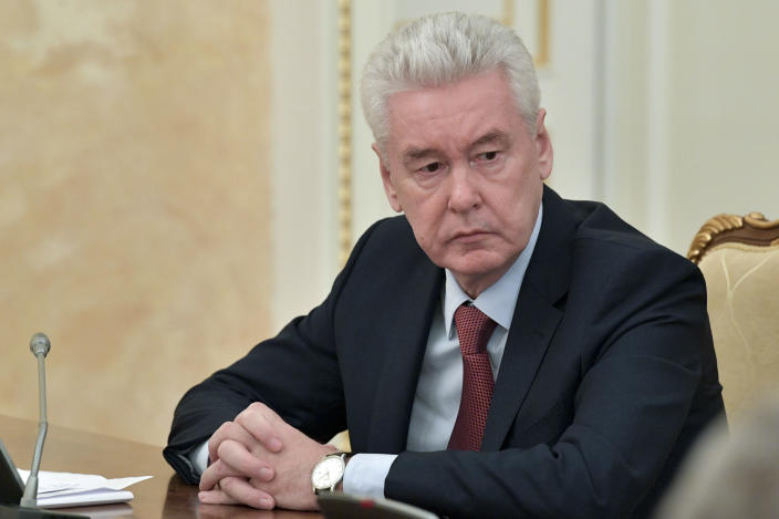 Moscow Mayor Sergei Sobyanin attends a cabinet meeting with Russian Prime Minister Mikhail Mishustin in Moscow, Russia, Monday, March 30, 2020. Sobyanin ordered a lockdown starting Monday requesting all city residents except those working in essential sectors to stay home except in cases of medical emergency and shop only at nearby stores or pharmacies. The new coronavirus causes mild or moderate symptoms for most people, but for some, especially older adults and people with existing health problems, it can cause more severe illness or death. (Alexander Astafyev, Sputnik, Kremlin Pool Photo via AP)