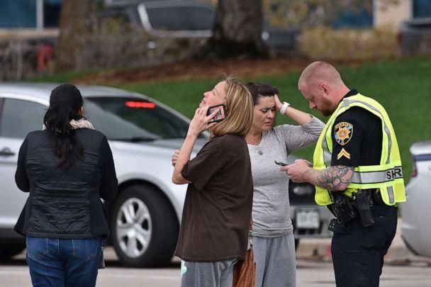 PHOTO: In this May 7, 2019, file photo, parents speak with a police officer at the scene of a shooting in which at least seven students were injured at the STEM School Highlands Ranch in Highlands Ranch, Colorado. (Tom Cooper/Getty Images, FILE)
