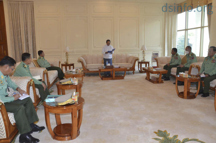 In this photo released by The Military True News Information Team, Myanmar Acting President Myint Swe, center, military chief Senior Gen. Min Aung Hlaing, third left, and other military members of National Defence and Security Council attend a meeting at Presidential Palace in Naypyitaw, Myanmar Monday, Feb. 1, 2021. (The Military True News Information Team via AP)