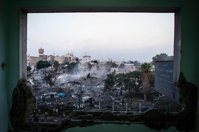 <p>Hours after a ceasefire was declared between Hamas and Israel, the people of Gaza City begin to rebuild. Shops open and families go out to witness the damage incurred by the recent strikes. (Photograph by Monique Jaques) </p>