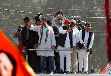 FILE PHOTO: Rahul Gandhi, Vice-President of India's main opposition Congress Party, and Akhilesh Yadav, Samajwadi Party (SP) President and Chief Minister of the northern state of Uttar Pradesh, wave to the crowd in Allahabad