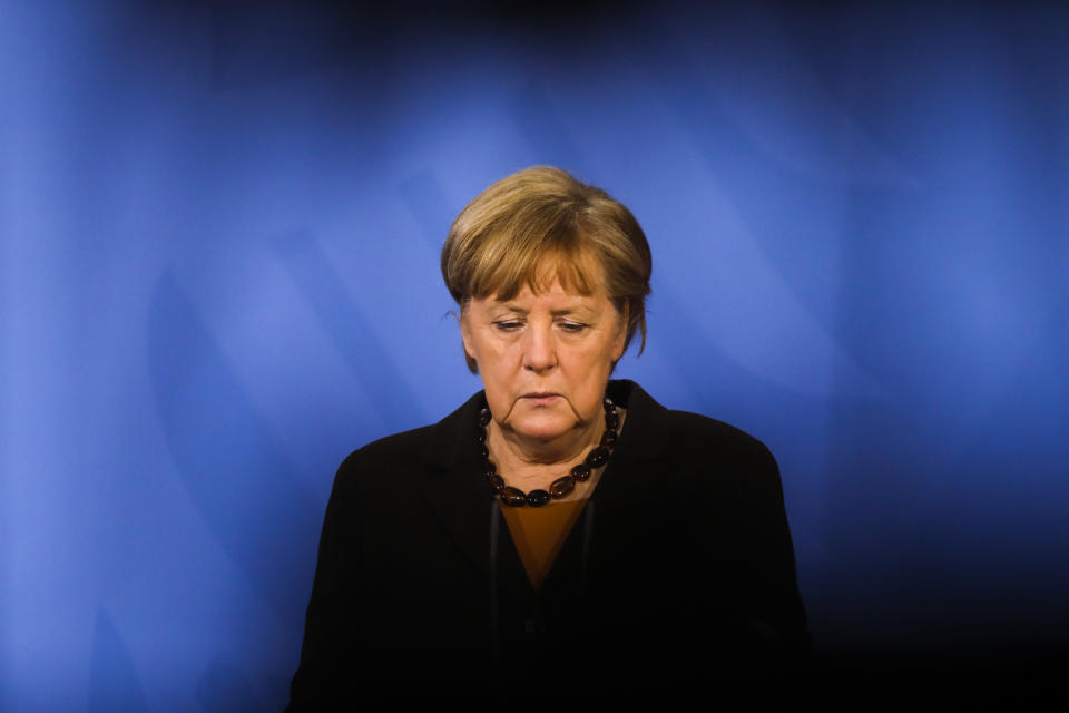 German Chancellor Angela Merkel briefs the media after a virtual meeting with federal state governors at the chancellery in Berlin, Germany, Tuesday, March 30, 2021. German health officials agreed Tuesday to restrict the use of AstraZeneca's coronavirus vaccine in people under 60 amid fresh concern over unusual blood clots reported from those who received the shots. (AP Photo/Markus Schreiber, pool)