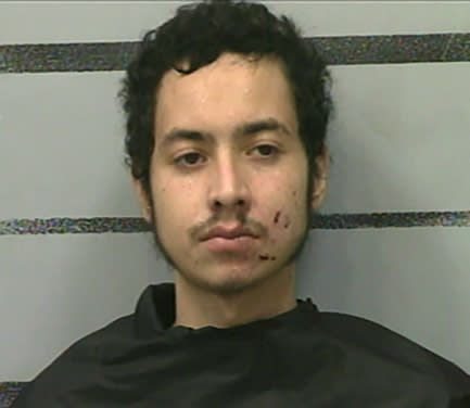 This photo provided by the Lubbock County Detention Center show Omar Soto-Chavira. Omar Soto-Chavira, a man charged in the fatal shooting of a SWAT officer in a small West Texas city during a standoff last week was charged Friday, July 23, 2021 with assaulting a federal officer who responded to the scene, prosecutors said. (Lubbock County Detention Center via AP)
