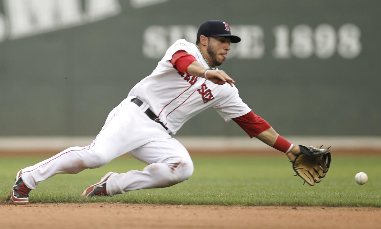 BOSTON, MA - JULY 7: Mike Aviles #3 of the Boston Red Sox can't get to a single by Derek Jeter #2 of the New York Yankees during the sIxth inning of game one of a doubleheader at Fenway Park on July 7, 2012 in Boston, Massachusetts. (Photo by Winslow Townson/Getty Images)