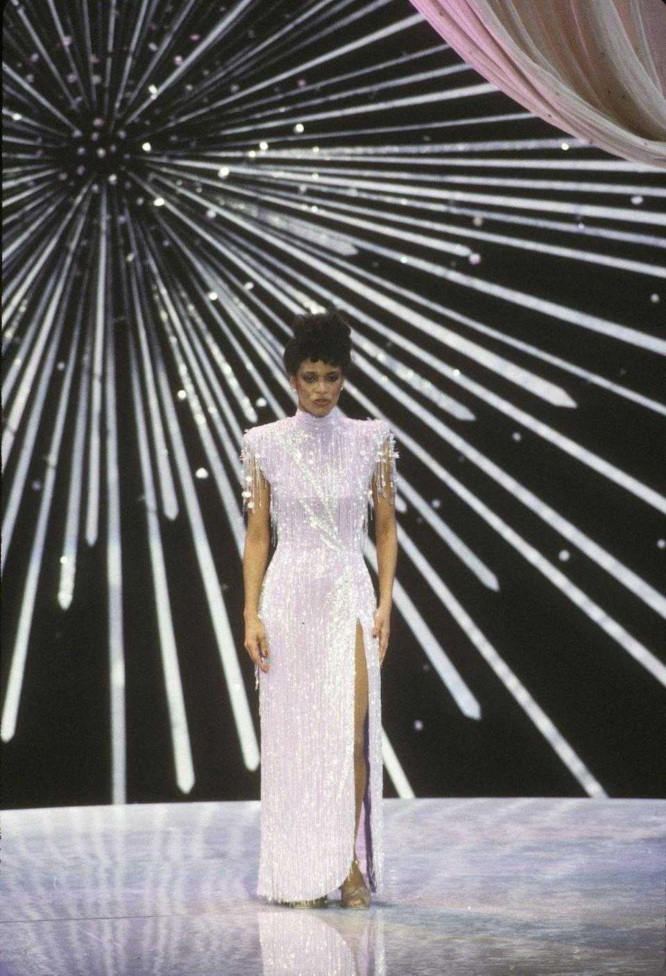 <p>A super high slit and a beaded fringe truly makes for a memorable AF Oscar look. The singer dazzled the crowd as she performed alongside Gregory Hines. </p>