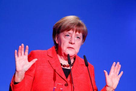FILE PHOTO: German Chancellor Angela Merkel gives a speech at the demographic summit in Berlin