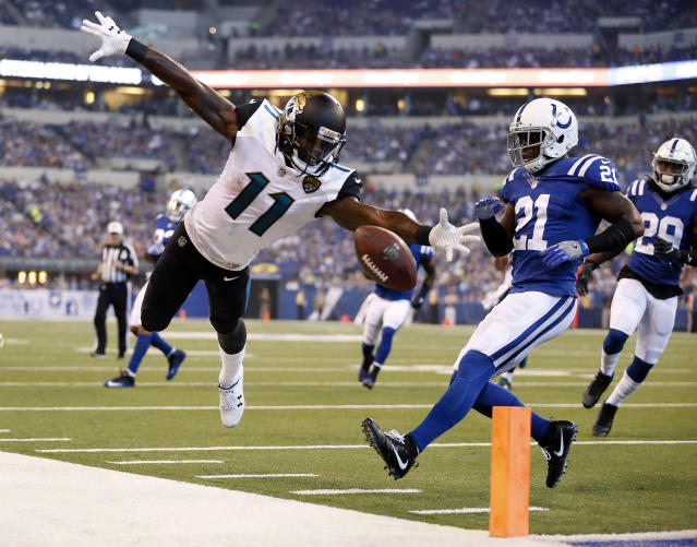 <p>Jacksonville Jaguars wide receiver Marqise Lee (11) looses the ball out-of-bounds after a catch in front of Indianapolis Colts cornerback Vontae Davis (21) during the first half NFL football game in Indianapolis, Sunday, Oct. 22, 2017. (AP Photo/Jeff Roberson) </p>