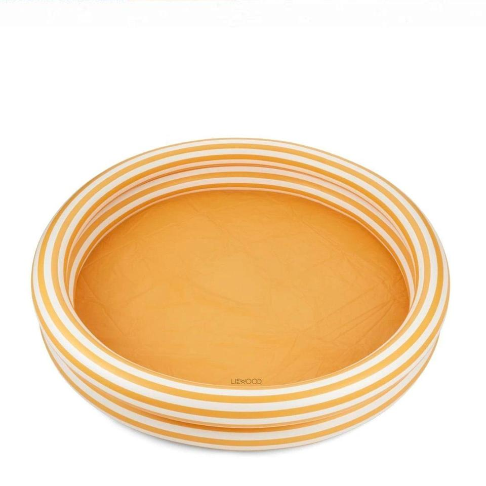 """This neutral stripe option is about as chic as a blowup pool gets. Leave it to the Swedes. $64, Scandibørn. <a href=""""https://www.scandiborn.com/products/liewood-savannah-pool-in-yellow-mellow-creme"""" rel=""""nofollow noopener"""" target=""""_blank"""" data-ylk=""""slk:Get it now!"""" class=""""link rapid-noclick-resp"""">Get it now!</a>"""