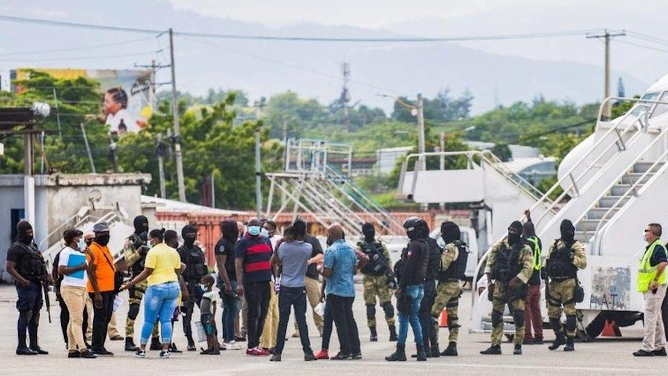 Haitian migrants gather in Port-au-Prince after getting off a plane from Texas