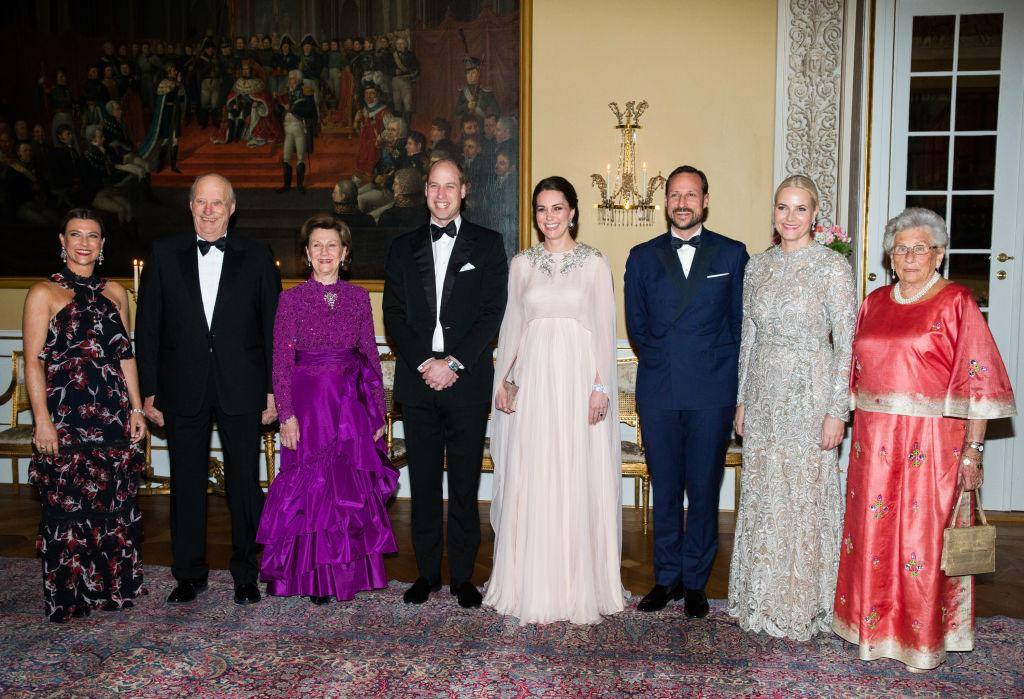 <p>To mark their first evening in Oslo, the Duke and Duchess of Cambridge attended an official dinner with the Norwegian Royal family at the Royal Palace.<br />For the prestigious event, the Duchess of Cambridge chose a powder pink-hued cape gown by Alexander McQueen. She accessorised the look with a diamond bracelet and co-ordinating earrings borrowed from Her Majesty. <em>[Photo: Getty]</em> </p>