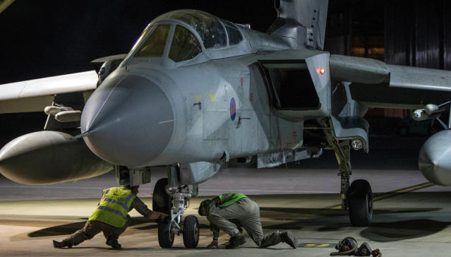 <p>In this image released by Britain's Ministry of Defense, an RAF Tornado taxis into its hangar after landing at Britain Royal Air Force base in Akrotiri, Cyprus, after its mission to conduct strikes in support of operations over the Middle East Saturday, April 14, 2018. (Photo: Cpl L Matthews/MoD via AP) </p>