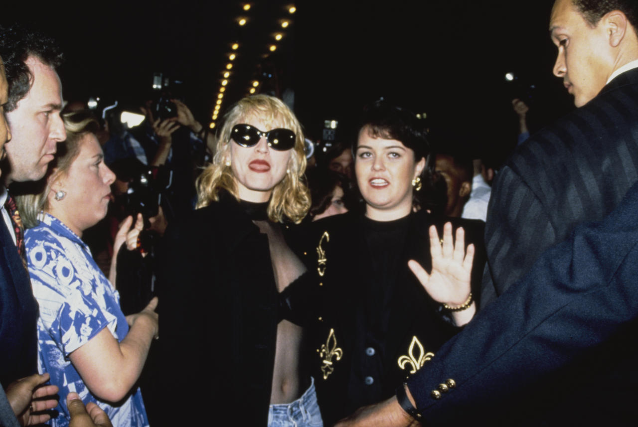 American singer Madonna (centre) and actress Rosie O'Donnell (right) attend the New York premiere of the film 'A League of Their Own', USA, 25th June 1992. They both star in the movie. (Photo by Vinnie Zuffante/Michael Ochs Archives/Getty Images)
