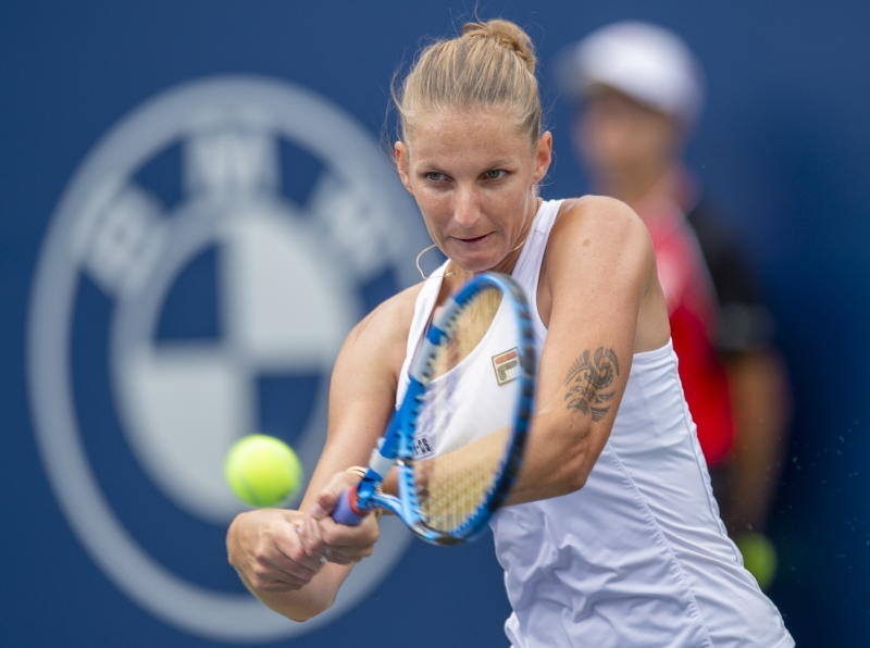 Karolina Pliskova, of the Czech Republic, hits a backhand to Bianca Andreescu, of Canada, during quarterfinal play at the Rogers Cup tennis tournament Friday, Aug. 9, 2019, in Toronto. (Fran Gunn/The Canadian Press via AP)