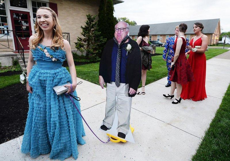 Clossbrought DeVito to her prom on a scooter (Associated Press)