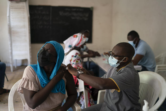 A health worker administers a dose of Janssen Johnson & Johnson COVID-19 vaccine at Dakar's Medina neighborhood, Senegal, Wednesday, July 28, 2021. In the midst of a third wave of the coronavirus pandemic, with many countries on the cusp, African health officials are racing to vaccinate populations that had before been reluctant or unable to access vaccines. (AP Photo/Leo Correa)