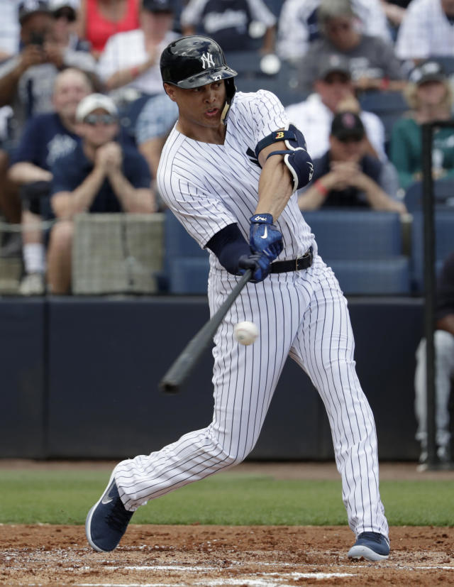 New York Yankees' Giancarlo Stanton bats during the first inning of a baseball spring exhibition game against the Detroit Tigers, Friday, Feb. 23, 2018, in Tampa, Fla. (AP Photo/Lynne Sladky)