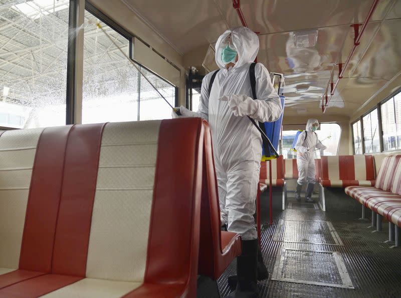 A trolley bus is disinfected amid fears over the spread of the novel coronavirus in Pyongyang
