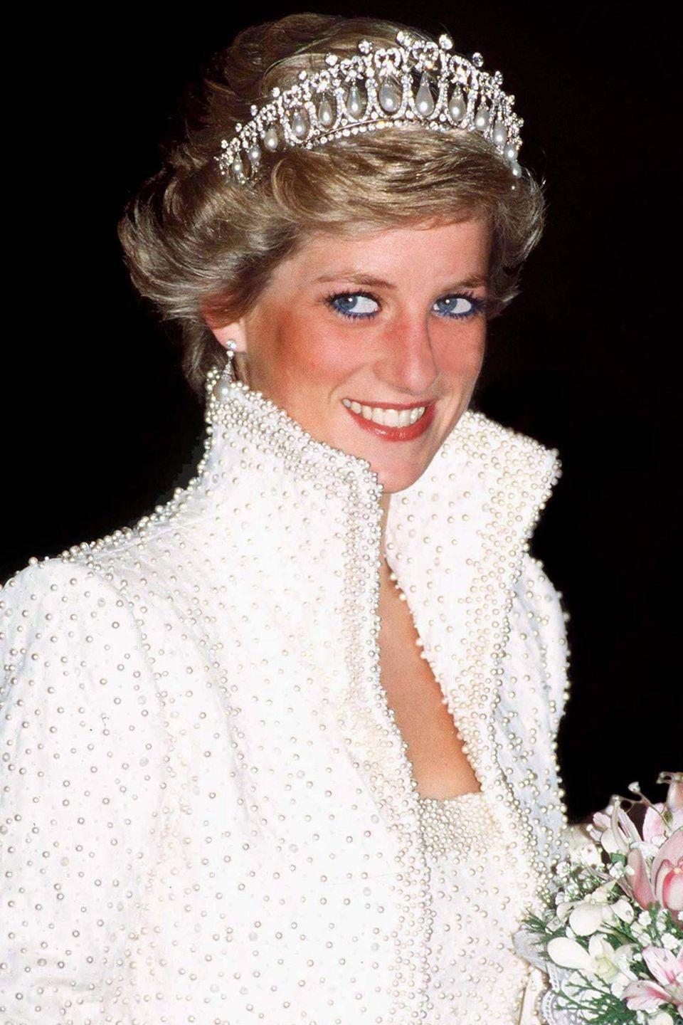 <p>In a diamond and pearl tiara during a visit to Hong Kong. </p>