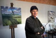 Artist Julian Bell poses for a portrait in his art studio in Lewes