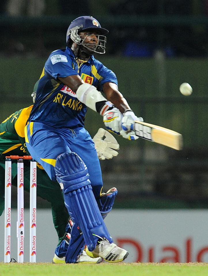 Sri Lankan cricketer Thisara Perera plays a shot during the third One Day International (ODI) cricket match between Sri Lanka and South Africa at the Pallekele International Cricket Stadium in Pallekele on July 26, 2013. AFP PHOTO/ Ishara S.KODIKARA        (Photo credit should read Ishara S.KODIKARA/AFP/Getty Images)