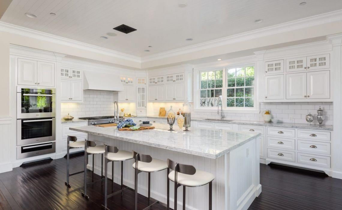 <p>Featuring gorgeous white marble, with Miele appliances, the chef's kitchen is another space you'd probably never want to leave. There's even a breakfast room as well.</p>