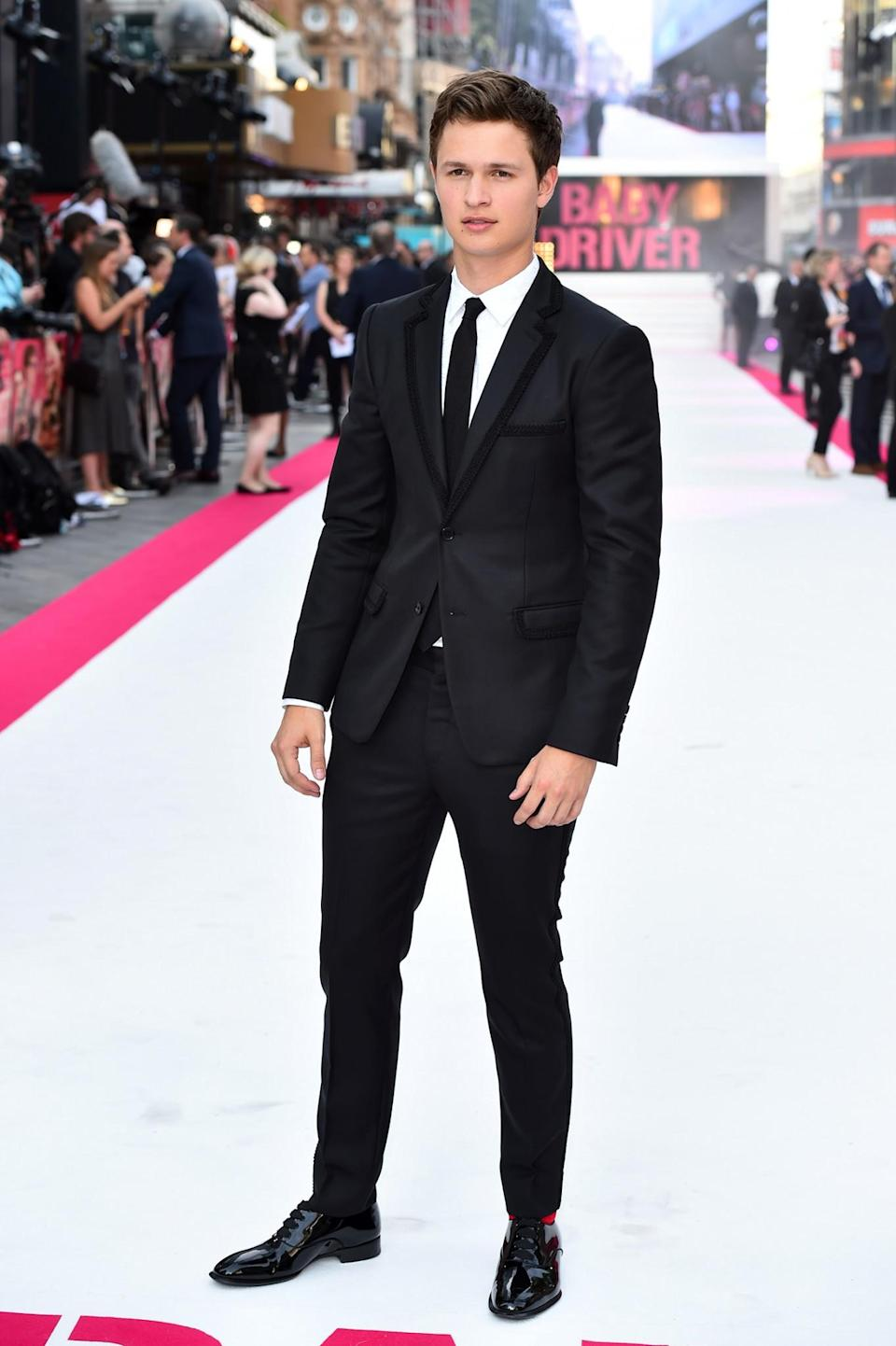 <p>The 'Divergent' series star scrubbed up nicely in a simple black suit with skinny tie. <br><em>[Photo: PA]</em> </p>