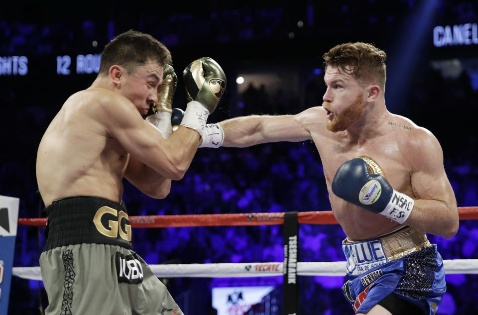 Canelo Alvarez, right, throws a right at Gennady Golovkin during their fight in Las Vegas on Saturday. (AP)