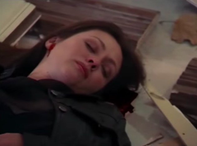 """Prue lying on the ground after being attacked by a demon on """"Charmed"""""""