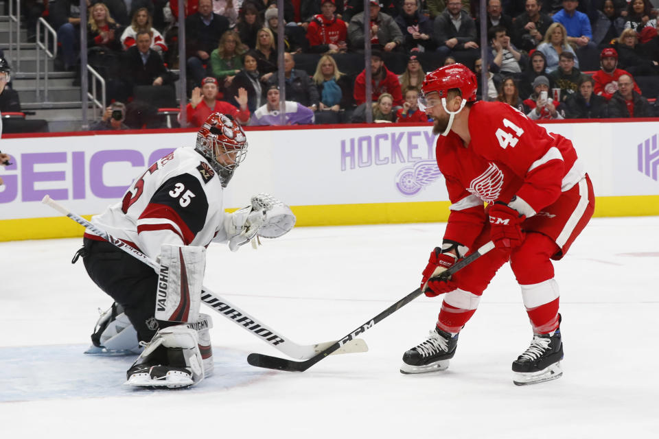 Detroit Red Wings center Luke Glendening (41) scores on Arizona Coyotes goaltender Darcy Kuemper (35) in the second period of an NHL hockey game, Tuesday, Nov. 13, 2018, in Detroit. (AP Photo/Paul Sancya)