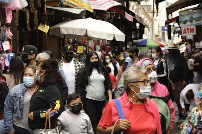 LOS ANGELES, CA - JUNE 7, 2021 - - Shoppers make their way through Santee Alley in downtown Los Angeles on June 7, 2021. California continues to help set the pace for U.S. COVID-19 recovery, now ranked by the Centers for Disease Control and Prevention as one of just two states at the lowest level of coronavirus community transmission. In fact, according to the CDC's four-level color-coded system, California's transmission metrics were the lowest out of all 50 states as of Saturday. The CDC determines the level of community transmission based on the number of cases in the last seven days per population of 100,000, and the number of tests in the last seven days that yield a positive result. JUNE 07: Los Angeles Monday, June 7, 2021 Los Angeles, CA. (Genaro Molina / Los Angeles Times)