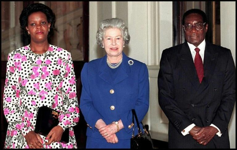 Britain's Queen Elizabeth II met Robert Mugabe and his wife Grace at Buckingham Palace in 1997