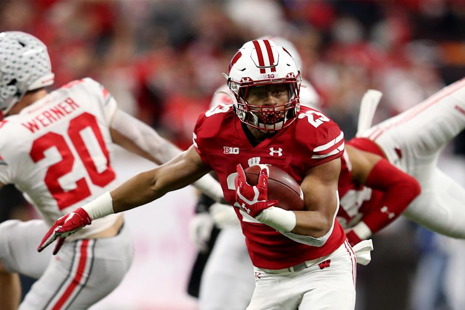 INDIANAPOLIS, INDIANA - DECEMBER 07: Jonathan Taylor #23 of the Wisconsin Badgers runs the ball in the Big Ten Championship game against the Ohio State Buckeyes at Lucas Oil Stadium on December 07, 2019 in Indianapolis, Indiana. (Photo by Justin Casterline/Getty Images)