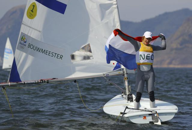 2016 Rio Olympics - Sailing - Final - Women's One Person Dinghy - Laser Radial - Medal Race - Marina de Gloria - Rio de Janeiro, Brazil - 16/08/2016. Marit Bouwmeester (NED) of Netherlands celebrates gold medal. REUTERS/Brian SnyderFOR EDITORIAL USE ONLY. NOT FOR SALE FOR MARKETING OR ADVERTISING CAMPAIGNS.