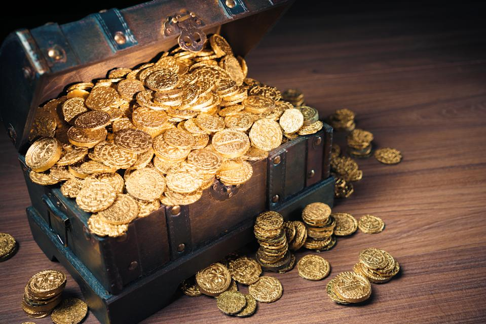 Open treasure chest filled with gold coins.