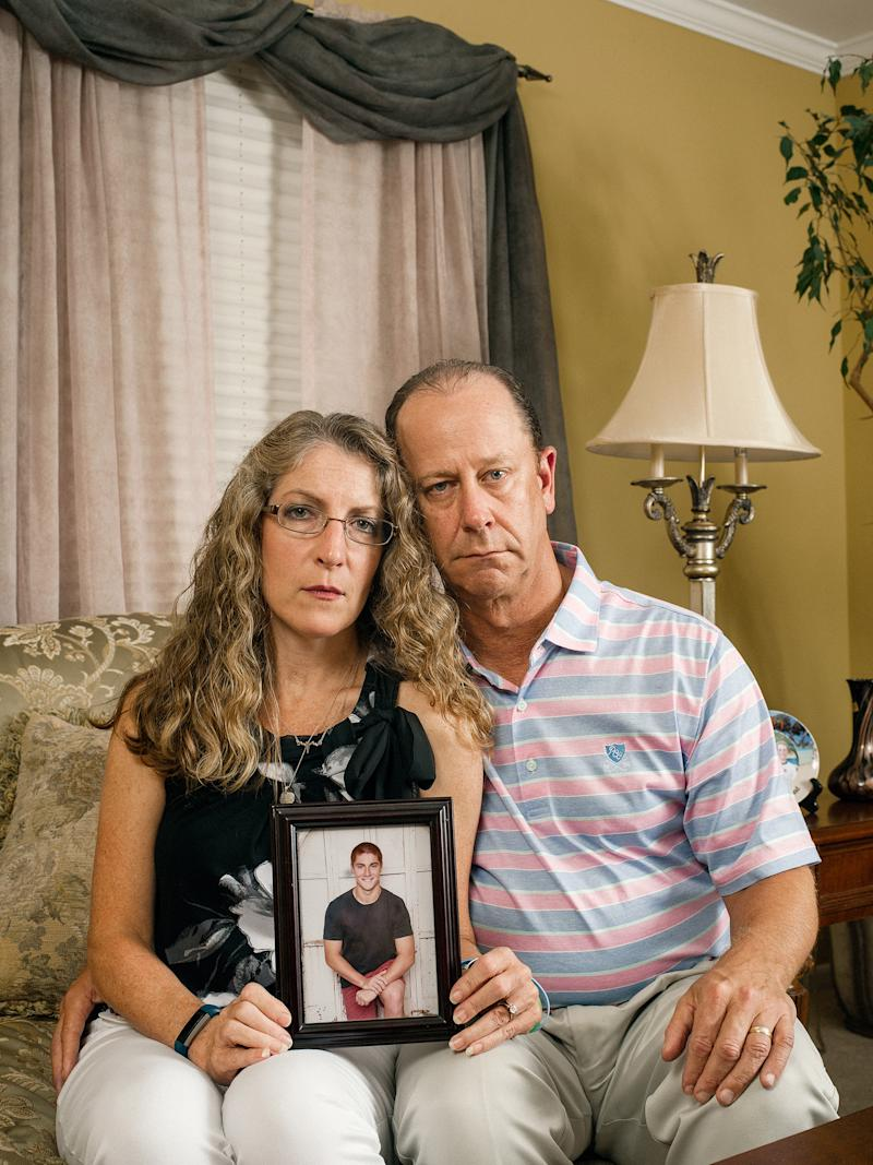 Evelyn and Jim Piazza with a photo of their son Tim, who died in February after a fraternity hazing ritual at Penn State University
