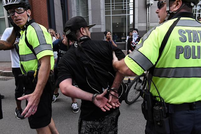 <p>A counter protester is detained by Boston Police outside of the Boston Commons and the Boston Free Speech Rally in Boston, Mass., Aug. 19, 2017. (Photo: Stephanie Keith/Reuters) </p>