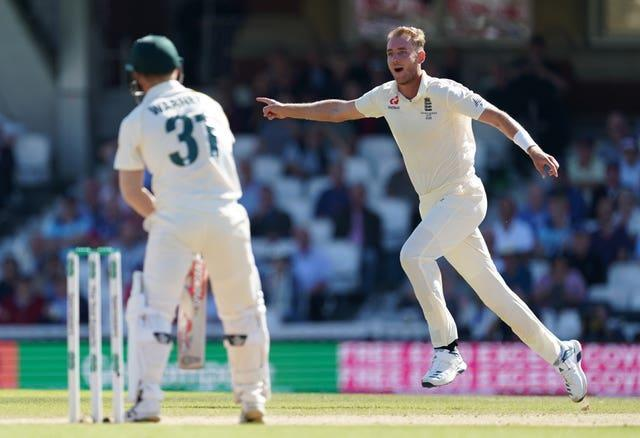 Stuart Broad, right, celebrates taking the wicket of David Warner at the Oval in 2019