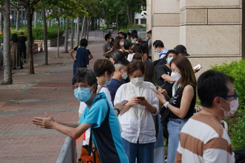 Supporters queue up for a court hearing outside West Magistrates' Courts, after police charge two executives of the pro-democracy Apple Daily newspaper over the national security law, in Hong Kong
