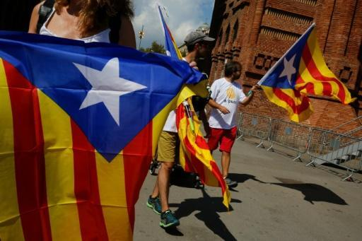 Catalan separatists rally to push for break from Spain